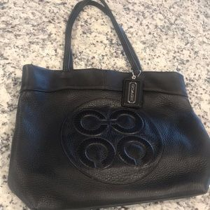 Chocolate brown Coach tote with 4 C logo